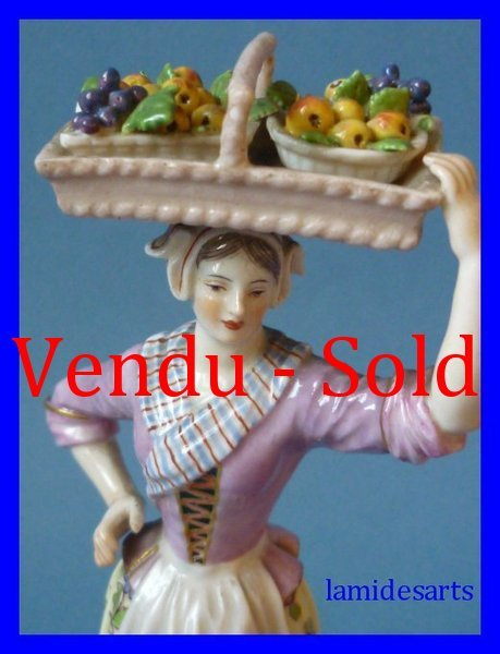 Meissen Porcelain Figure of a woman with hen and eggs
