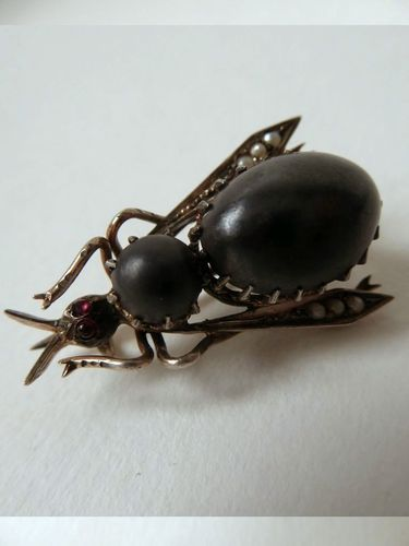 SILVER BROOCH IN A SHAPE OF A FLIE set with iron stones pearls and rubies